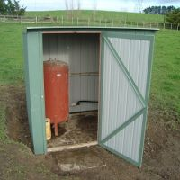 Pump shed and pressure tank